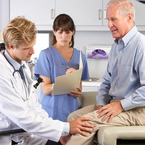 doctor checks for osteoarthritis in patient