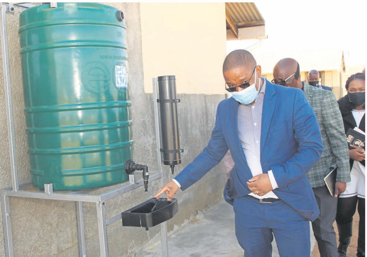 Education MEC Kwazi Mshengu waits to wash his hands at a water tap installed at Phumelela Secondary School in Msinga on 11 June.