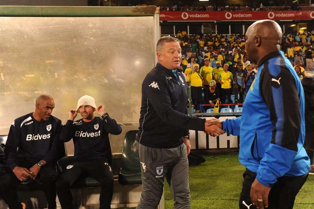 Pitso Mosimane of Mamelodi Sundowns and Gavin Hunt of Bidvest Wits team remember Mama Winnie Mandela during the Absa Premiership match between Mamelodi Sundowns and Bidvest Wits at Loftus Versfeld Stadium on April 14, 2018 in Pretoria, South Africa.