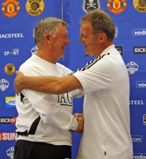 Manchester United manager Sir Alex Ferguson (left) greets new Pirates coach Rudi Krol at King's Park, Durban.