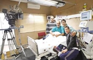 Daymed's Dr Navin Dayanand (left) with Bollywood actors Vipin Sharma and Ashmit Patel and director Brad Glass on the set of Florida Road during a break in filming at the hospital in Northdale yesterday.