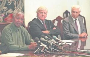 Former president Nelson Mandela (left) pictured with deputy TRC chair Alex Boraine (centre) in 1996.
