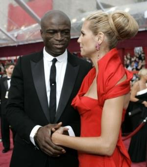Model Heidi Klum, with her husband Seal, was among the stars who dazzled in red.