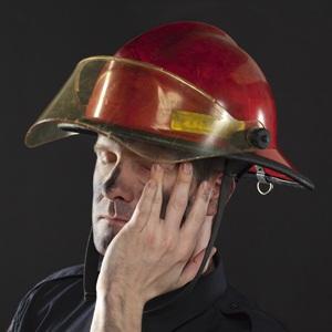 Tired fireman from Shutterstock