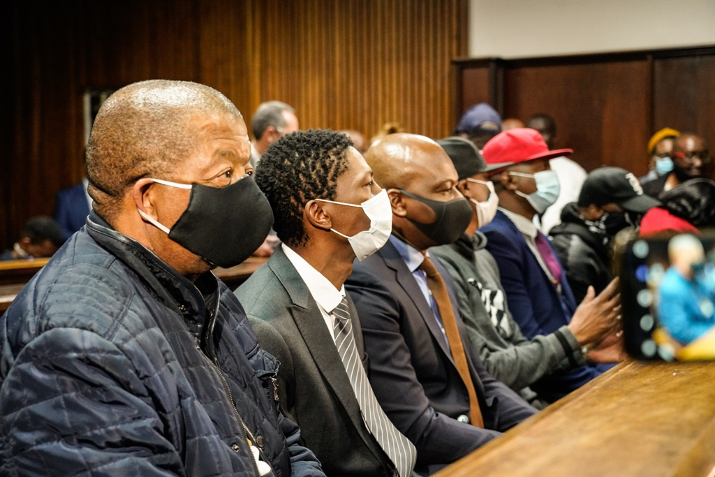The seven accused in the controversial asbestos contract case seated at the dock in the Bloemfontein High Court.