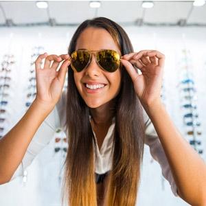 Woman wearing sunglasses to prevent eye disease