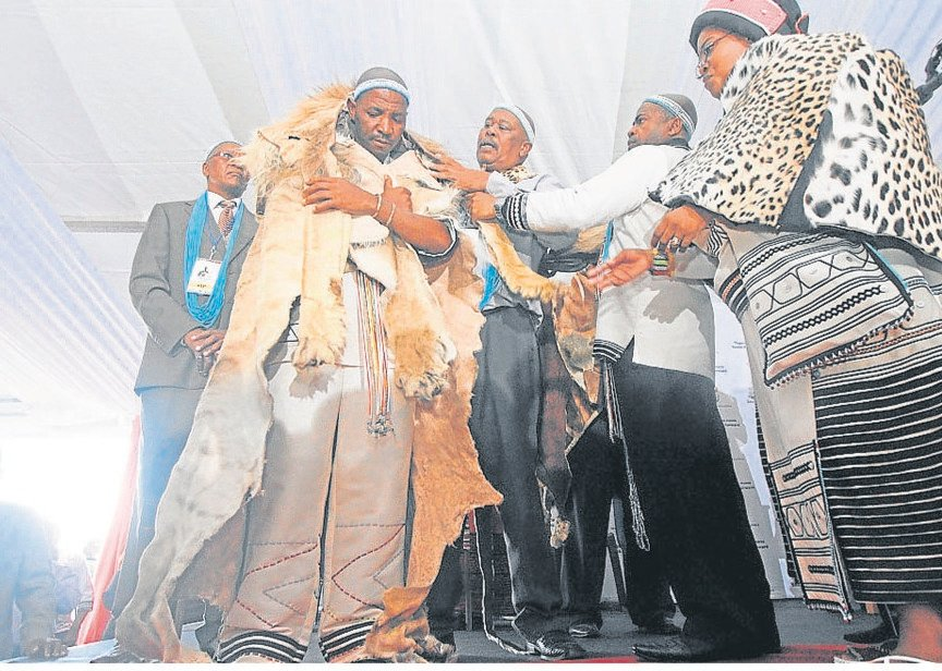 King Mpendulo Zwelonke Sigcawu is enrobed by AmaRharhabe Queen Regent Noloyiso Sandile during his coronation in Nqadu Great Place in Nqadu, Gatyane.