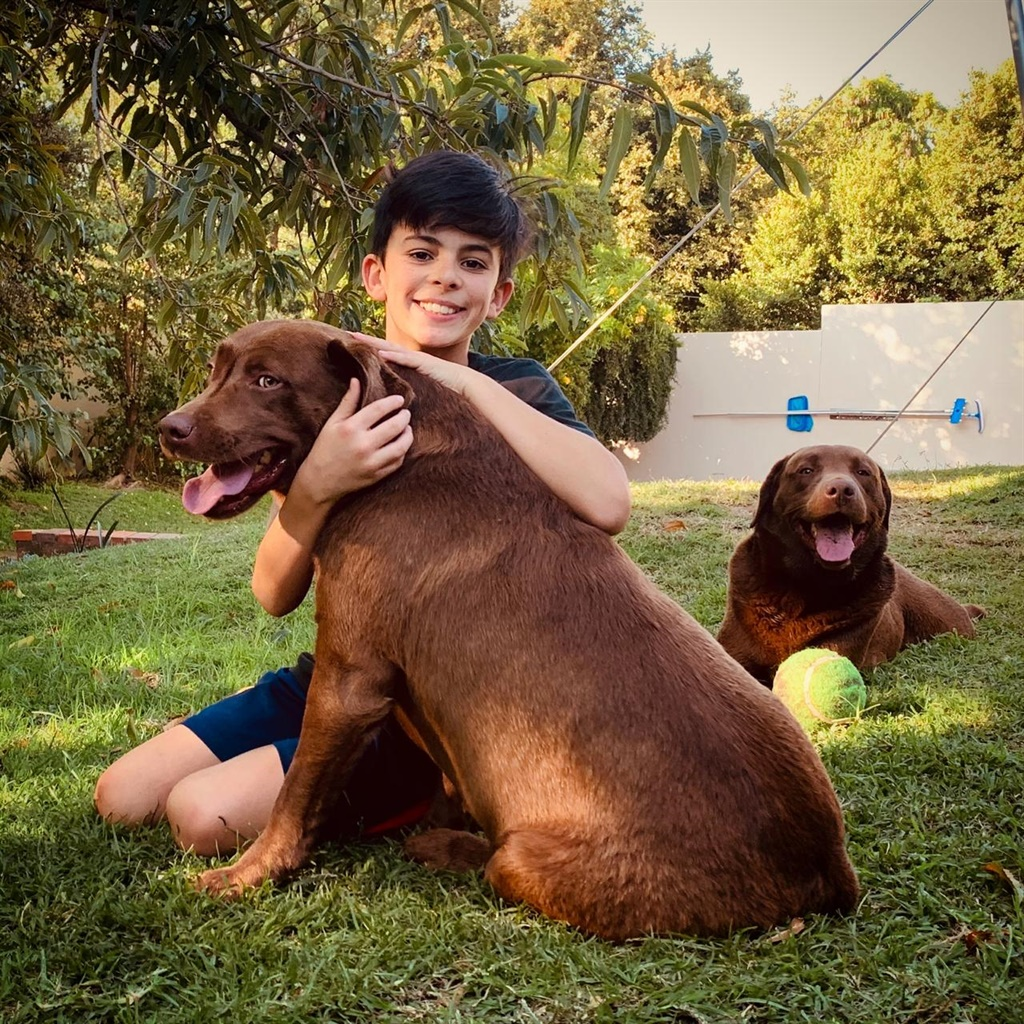 Chris Krokos with the dogs that 'ate his homework'