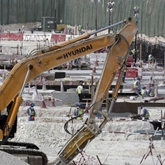 Workers use heavy machinery at a stadium in Doha, Qatar, being built for the 2022 World Cup. (Maya Alleruzzo, AP)
