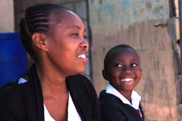 Tamara Dayi and her son Siphiwo at their home in K