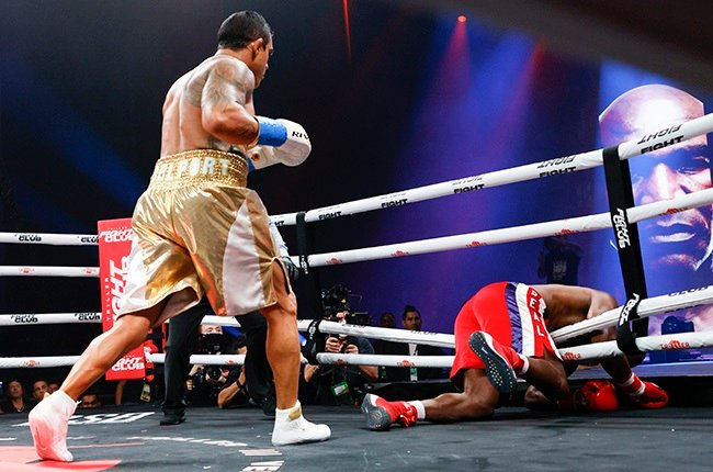 Vitor Belfort knocks down Evander Holyfield during the first round. (Douglas P. DeFelice/Getty Images)