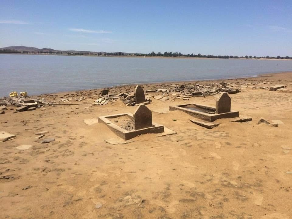 Graves submerged beneath the Vaal Dam.