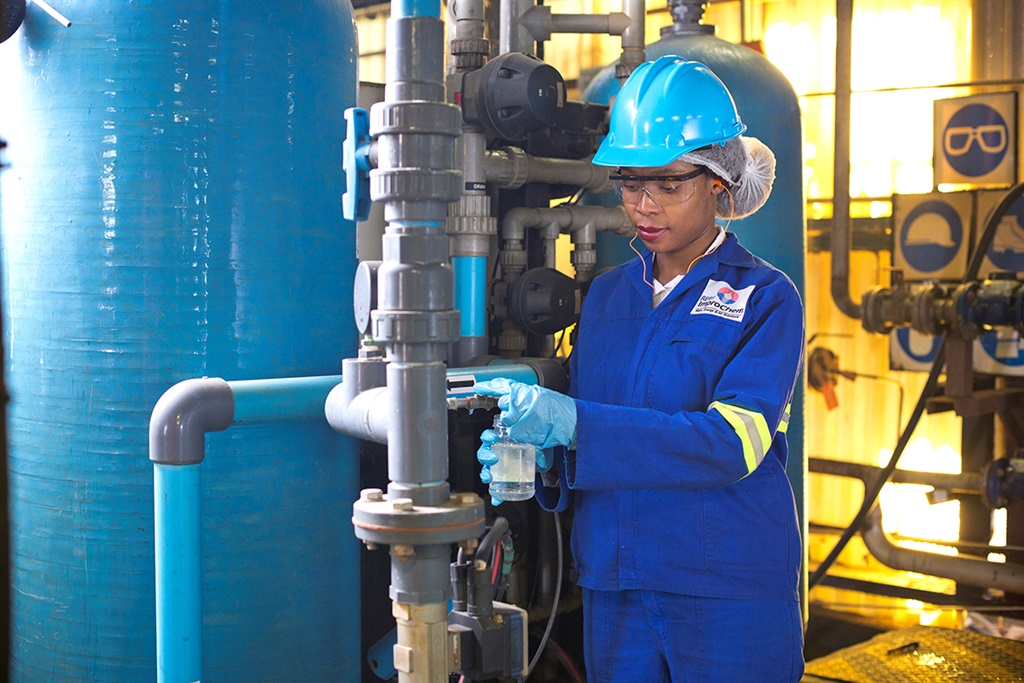 A worker at AEC's water processing facility ImproChem