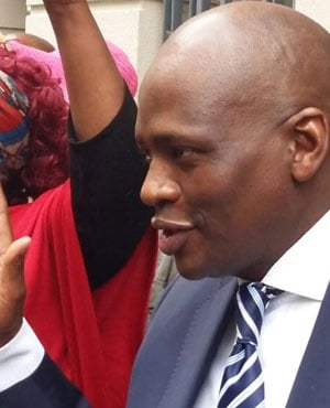 Hlaudi Motsoeneng greets supporters outside the High Court in Cape Town. (Jenni Evans, News24)