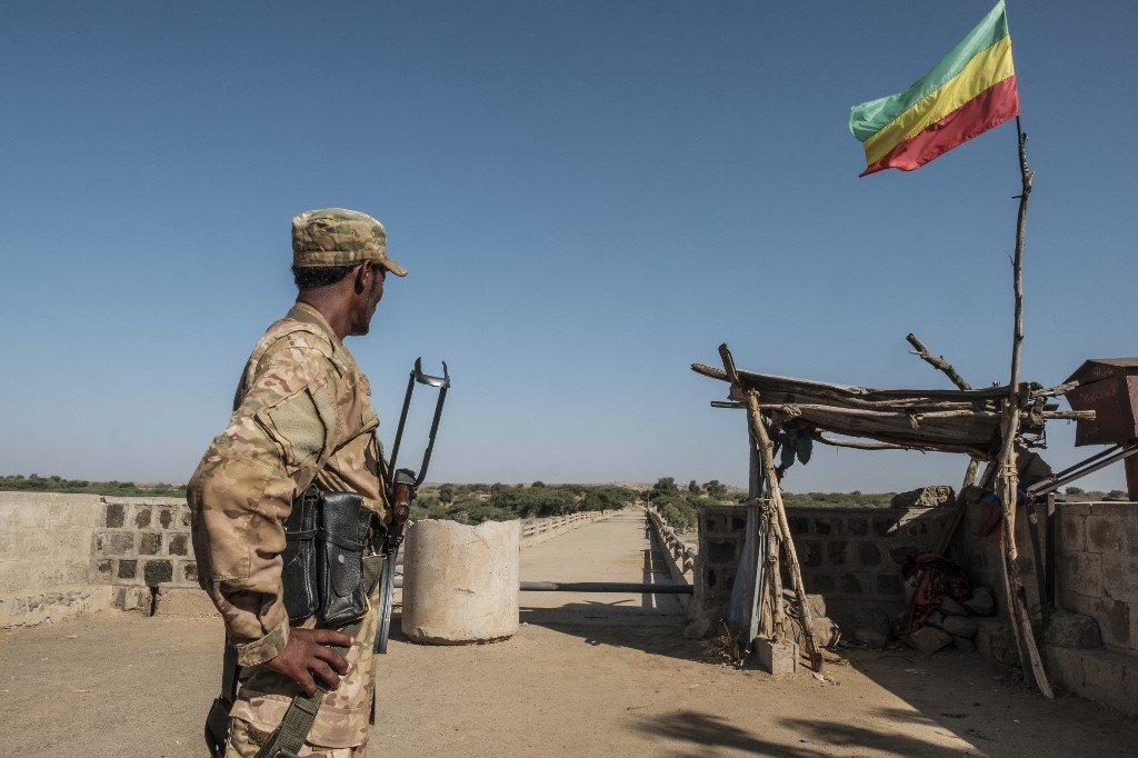 A member of the Amhara Special Forces watches on at the border crossing with Eritrea while where an Imperial Ethiopian flag waves, in Humera, Ethiopia, on November 22, 2020.