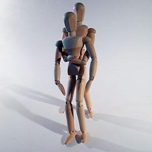 Wooden figurines executing the Heimlich Maneuver
