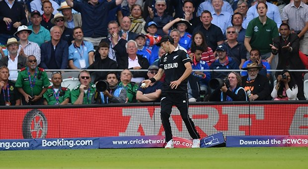 Trent Boult of New Zealand treads on the boundary after taking a catch (Getty Images)
