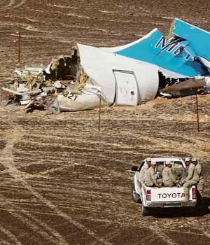 Members of the Egyptian military approach the Metrojet Airbus A321's wrecked tail. The passenger jet was flying from Sharm el-Sheikh to St Petersburg in Russia when it crashed in northern Sinai last weekend  Picture: Maxim Grigoriev / Russian Minist