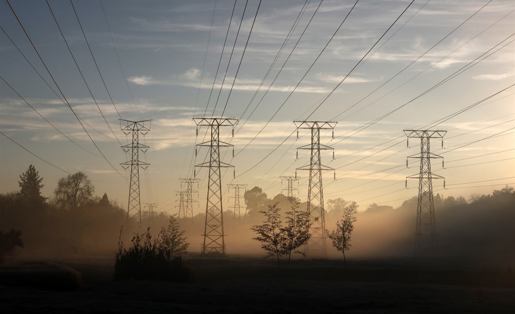 Power cables from Eskom are seen running through the morning mist in Johannesburg. Picture: Kim Ludbrook/EPA