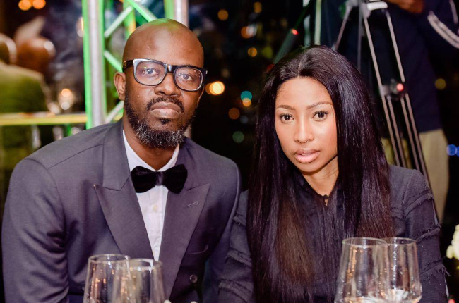 DJ Black Coffee has denied laying a hand on wife Enhle.