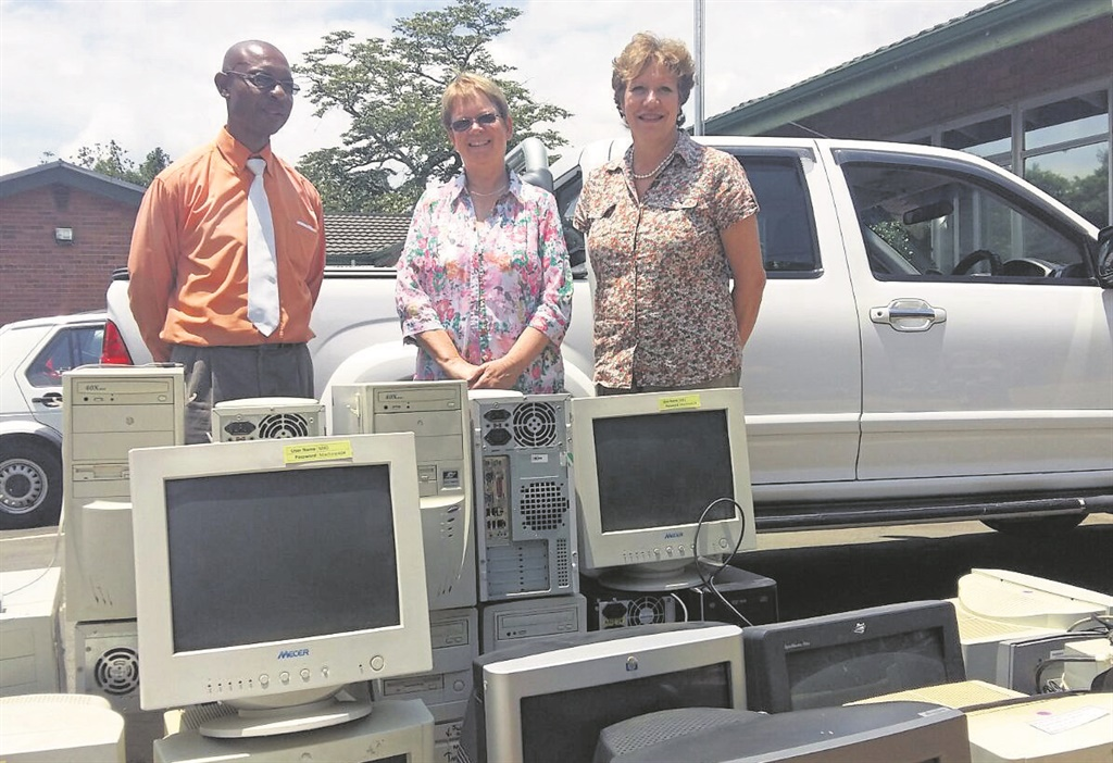 With the donated computers and printers (from left) Hlelingomuso deputy principal, Sipho Mnikath, Ridge principal Ann Dudley, and Ridge deputy principal, Sandra Pretorius. PHOTO: supplied