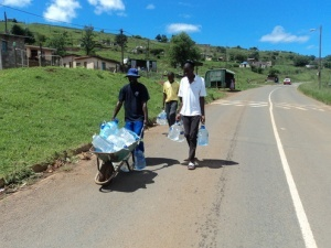 PHOTO: supplied KwaPata residents with some of the bottled water provided by Gift of the Givers.