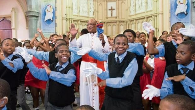 Children from the signing choir from the Kwa Thintwa School for the Deaf perform for Cardinal Wilfrid Napier at his 75th birthday celebration, which was held on Friday at the Emmanuel Cathedral in Durban.