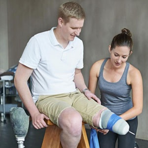An amputee is attended to by a physiotherapist. Image: Istock