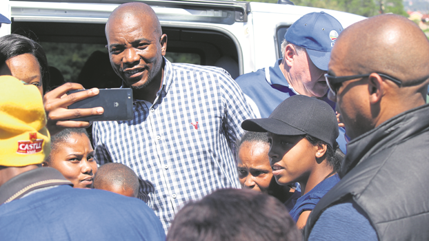 DA leader Mmusi Maimane poses for pictures with party members in Woodlands on Monday.