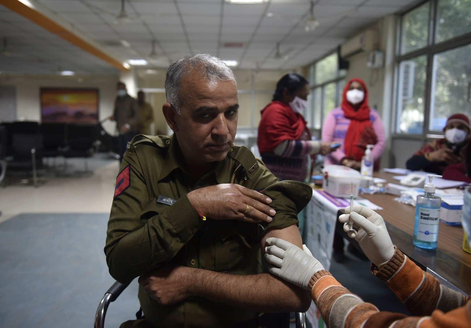 A health worker administers the AstraZeneca vaccine to a member of the Gurugram Police in Gurugram, India on February 5, 2021.