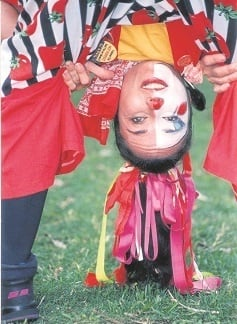 """""""I had forgotten that with white-face make-up, massed ribbons in my hair, a red. white and black- coloured costume, I probably appeared like a sangoma."""