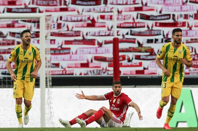 Is there anybody there? Benfica's Moroccan midfielder Adel Taarabt protests during the Portuguese league match against CD Tondela in front of a wall of scarves in the absence of spectators.