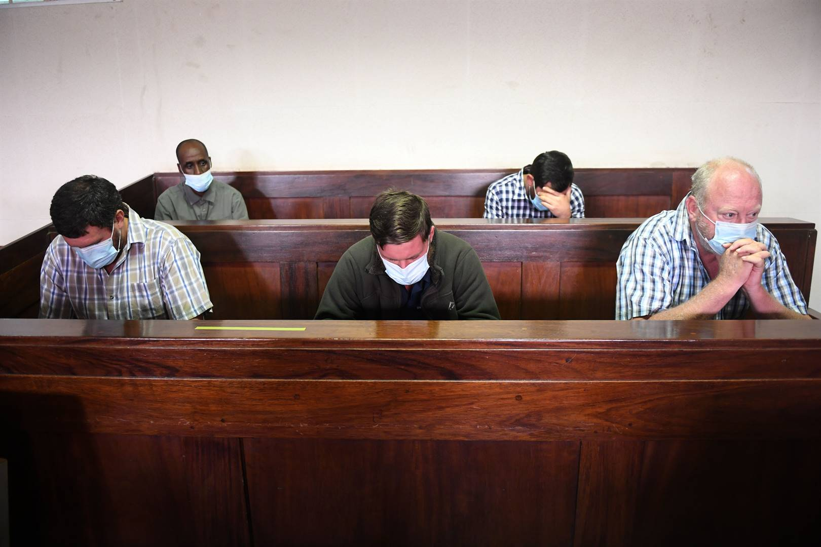 The five accused in the murder of the Coka brothers in the Piet Retief Magistrate's Court.