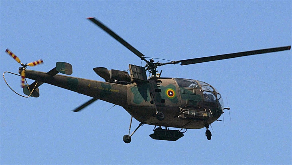 A Zimbabwean Air Force Helicopter flies near Harare.
