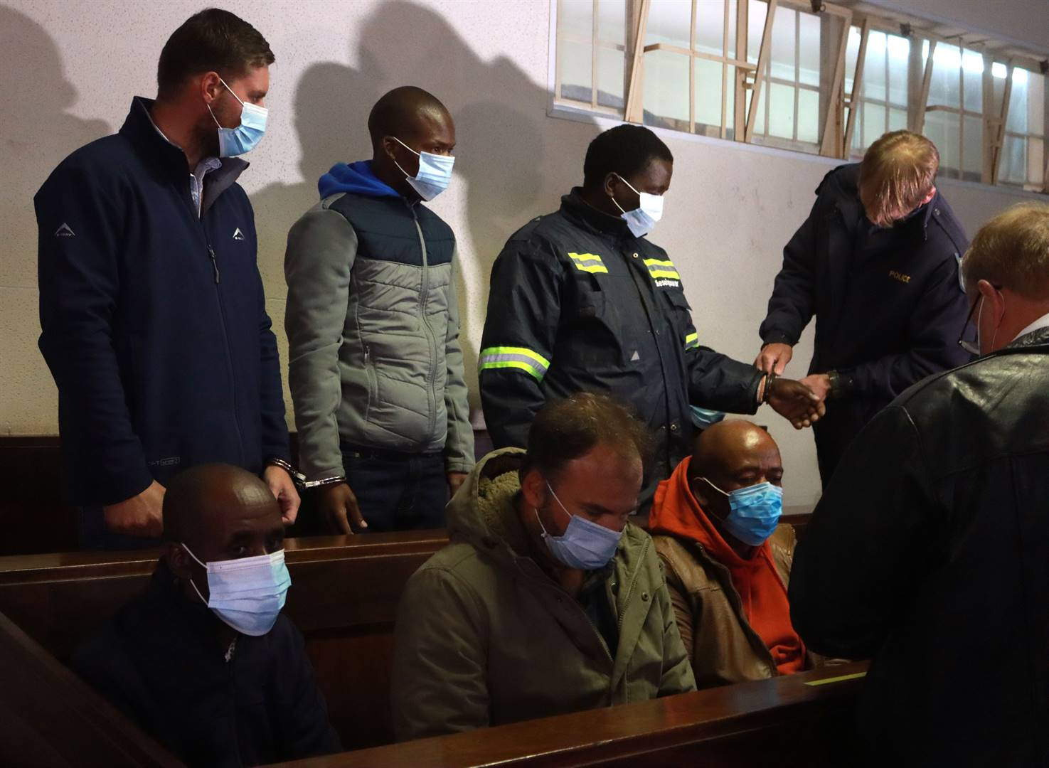 Eight men appeared in the Piet Retief Magistrate's Court for the alleged murder and assault of three people on the farm Pampoenkraal on 9 August 2020.