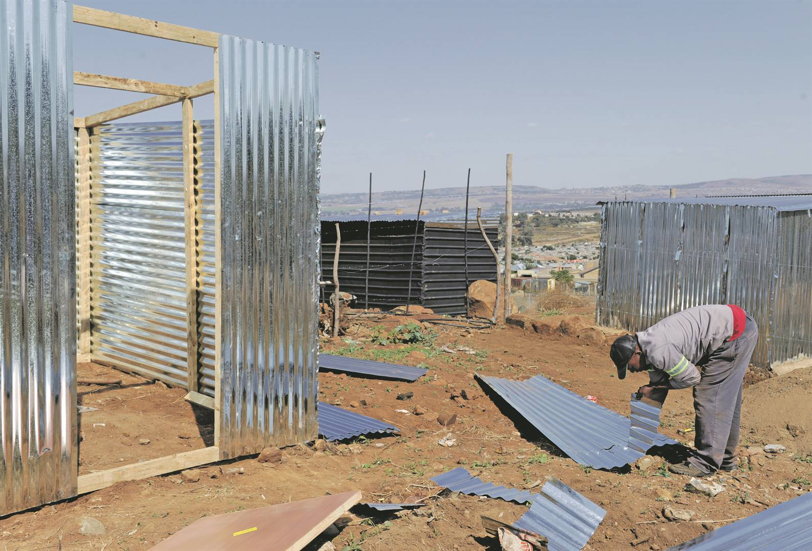 Freddy Mohale has been busy building shacks for customers in an informal settlement in Freedom Park near Naturena, south of Johannesburg.  Photo: Tebogo Letsie