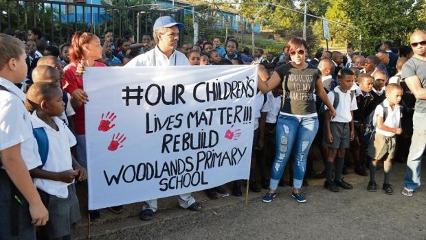 Teachers and pupils protest outside Woodlands Primary School
