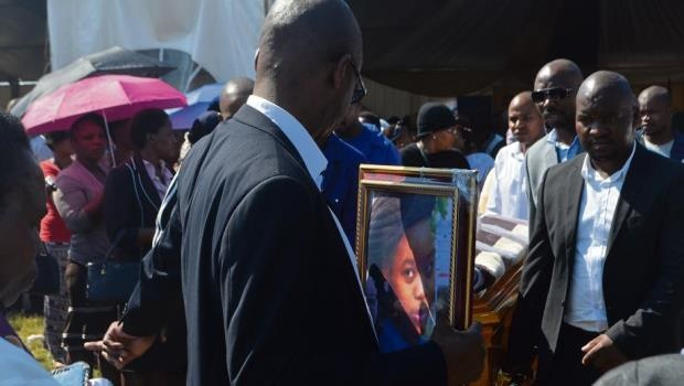 The family of Mbali Mvulani (21) leave the joint funeral ceremony to bury her on Saturday.