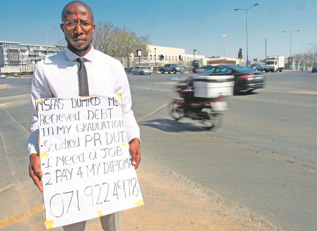 Thembinkosi Phakathi, an unemployed youth who begs at the corner of Rivonia Road and Sandton Drive in Johannesburg, is a public relations graduate who has taken to the streets to beg for a job. Picture: Gallo Images/Sowetan/Antonio Muchave