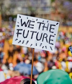 A student holds a banner aloft during the march to the Union Buildings in Pretoria yesterday.