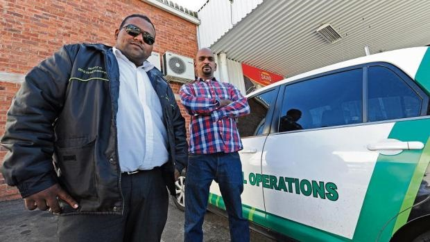 Metro Protection Services' Avinash Mahadave and Phoenix Cash and Carry security manager Alan Vadivelu who both took the initiative to help two officers in arresting an alleged robbery suspect in Victoria Road on Monday.