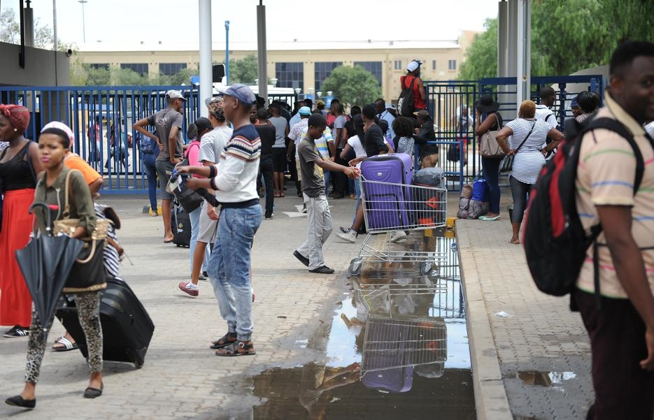 Students leaving North West University's Mafikeng campus after the unrest earlier in the year. Picture: Felix Dlangamandla/File