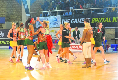 Go for it: The North West Flames celebrate their victory over the Gauteng Fireballs at the Mangaung Indoor Sports Centre. Picture: Silver Sibiya
