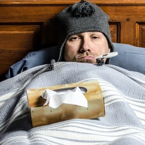 Man sick with flu in bed