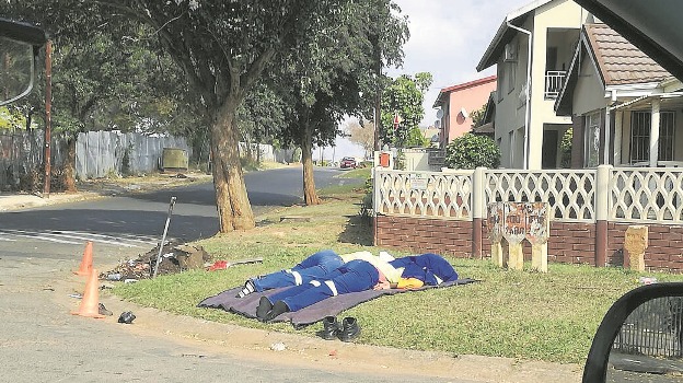According to nearby residents, these two municipal workers lay like this for about 45 minutes after 9?am last Thursday. The picture was captured on the corner of Cyprus Way and Olive Crescent in Newholmes.