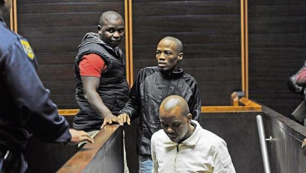 Cash in transit robbers Thulani Doncabe (in front), followed by Siboniso Mpanza and Sandile Shongwe make their way to the court cells. They were each handed five life sentences plus 186 years' imprisonment by Judge Rishi Seegobin.