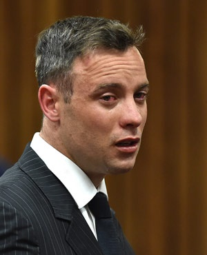 Oscar Pistorius, cries as he appears in the High Court for re-sentencing proceedings, in Pretoria. (Phill Magakoe, Pool Photo via AP)