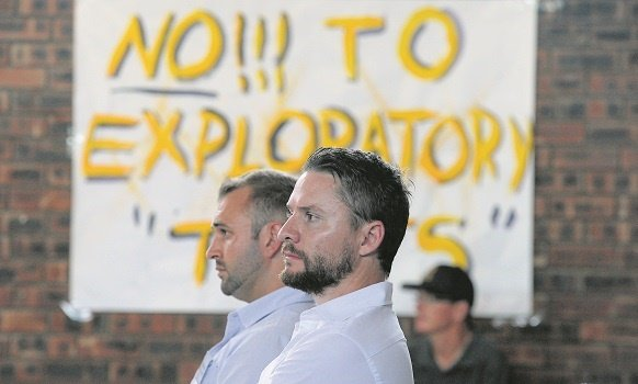 Rhino Oil geo-scientist Travis Smithard (left) and Rhino Oil and Gas South African director Phillip Steyn at a exploration right meeting in Howick West Hall earlier this year.