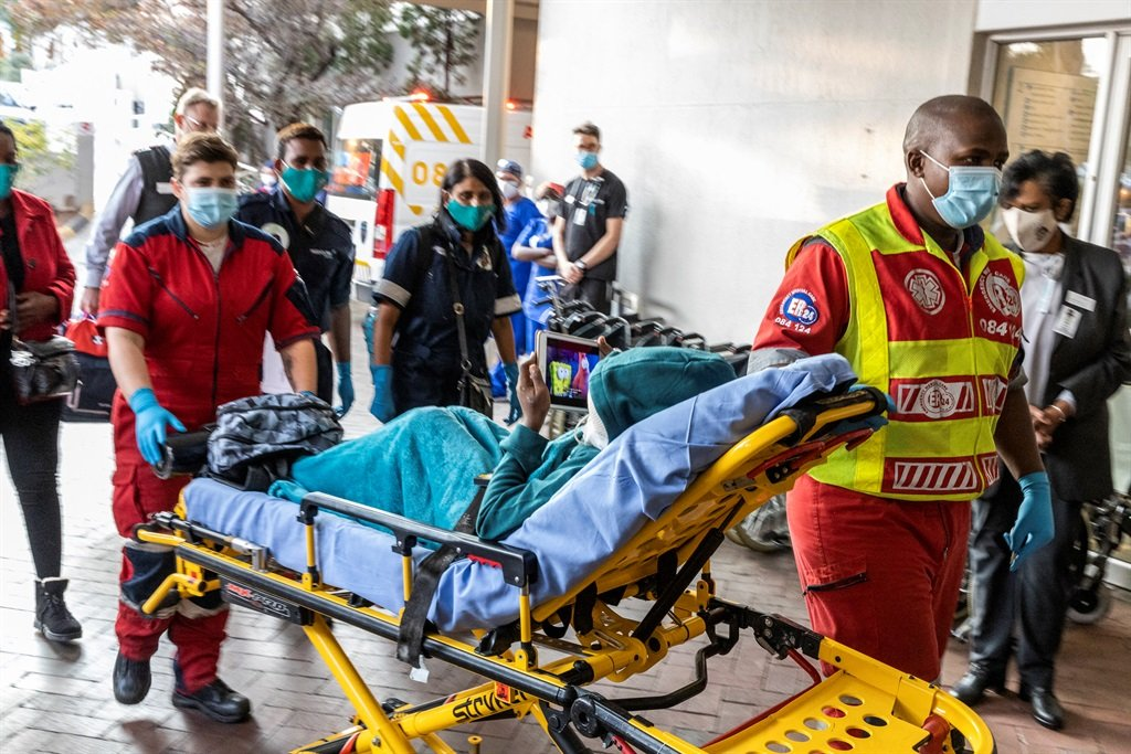 Rodwell Khomazana is taken into the hospital on a gurney at the Mediclinic in Sandton on 19 June 2021.