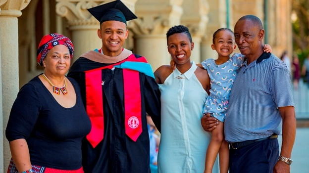 Monde Nkosi (second from left), head prefect at Kearsney College in 2007, poses with (from left) his mother Nomsa, wife Nyaki, daughter Nkanyezi and father Phillip after graduating from Stanford University in America last week. Nkosi was a top student in his MBA class and became the first black South African to receive the prestigious Arjay Miller award.